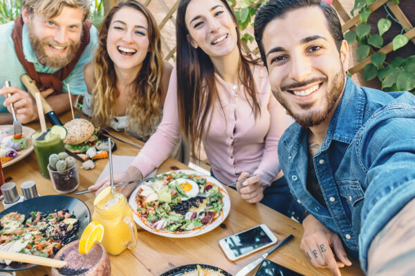 Happy Friends Taking Selfie With Mobile Smartphone While Lunchin